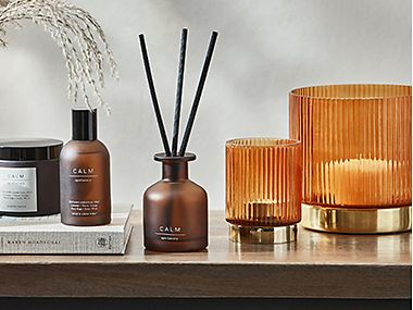 Scented candles, diffuser and room spray