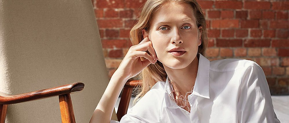 Woman wearing white cotton shirt