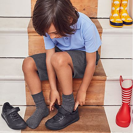Boy trying on school shoes