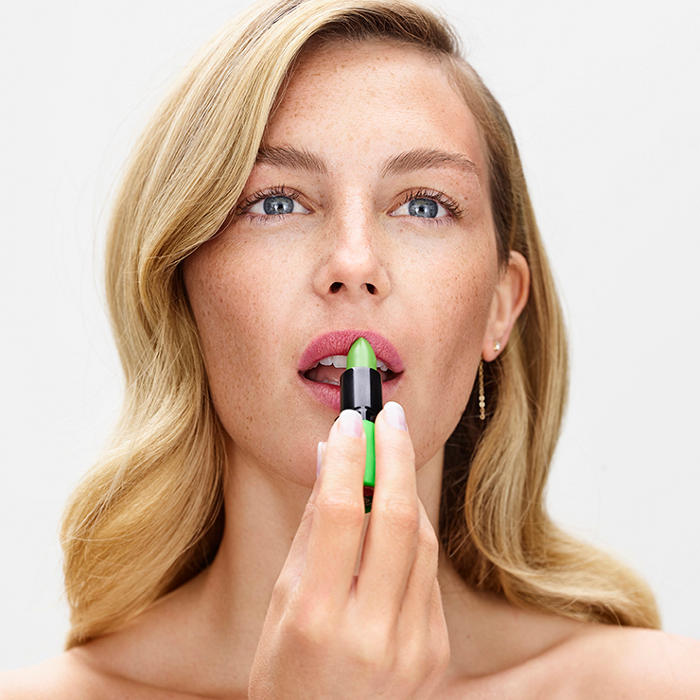 Woman applying Barry M Genie Lip Paint