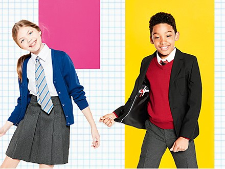 Boy and girl wearing school uniform