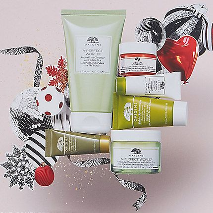 Collection of Origins skin care next to festive ribbons and motifs