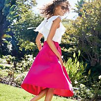 Woman in pink midi skirt