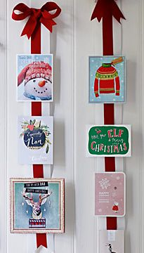 Christmas card holders with pegs and strings