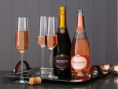 Prosecco bottle and Bellante sparkling rosé with three filled flutes