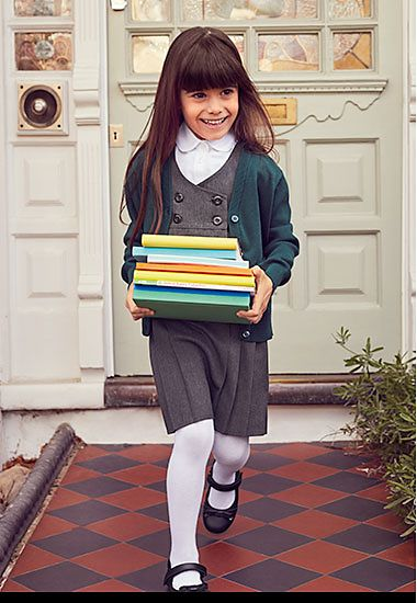 Girl carrying pile of school books