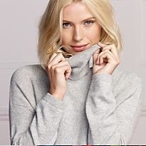 Woman wearing cashmere polo neck jumper