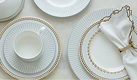 Dinner plates, side plates, cups and saucers