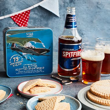 Spitfire tin with shortbread and beer
