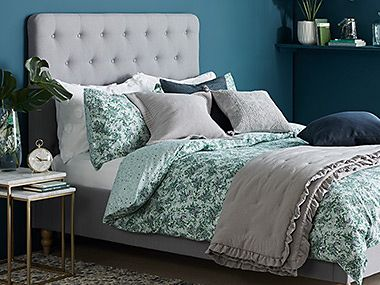 Grey Amelie bed with buttoned headboard