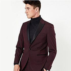 Man wearing burgundy suit