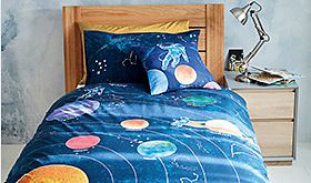 Wooden children's bed with space-themed bedding