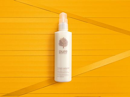 Pure Hot Cloth Cleanser on a yellow background