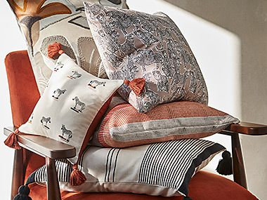 Pile of cushions on an arm chair