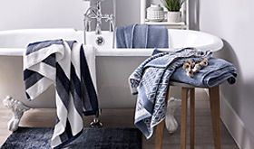 Free-standing bath in bathroom with towels