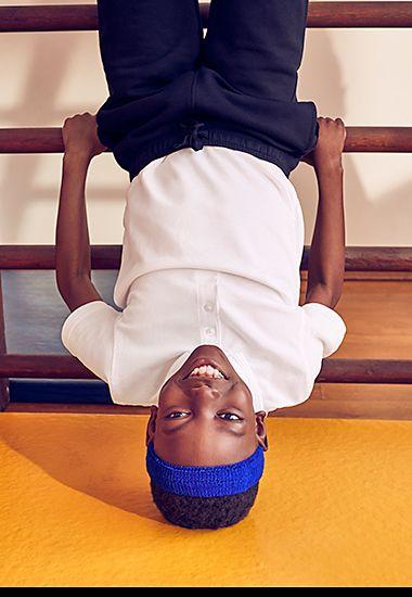 Boy wearing M&S white school polo shirt