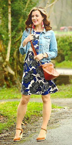 Blogger Rachel Turore wearing a floral-print dress and denim jacket