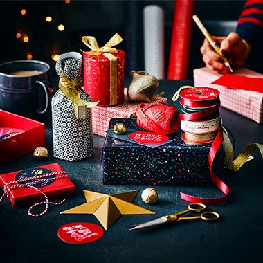 Christmas wrapping paper, ribbons and tags