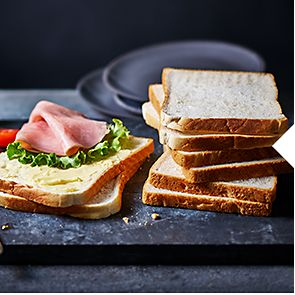 Sliced bread with ham and lettuce