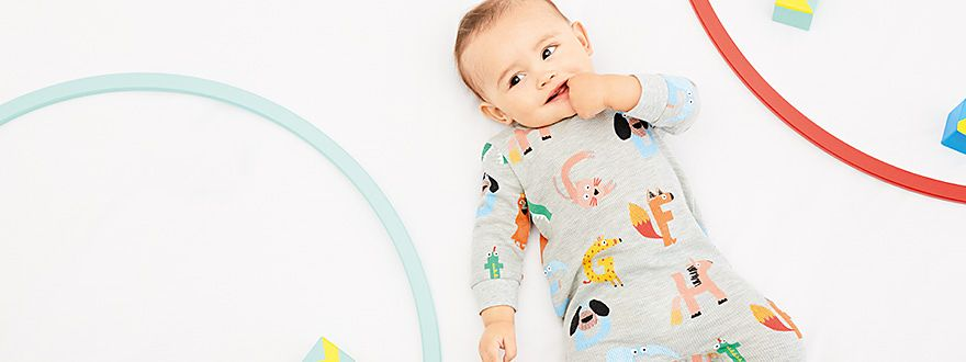 Baby boy in animal babygrow