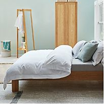 Sonoma wooden bed with grey and white bedding