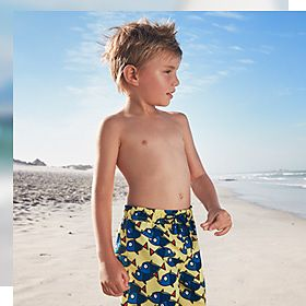 Boy in swimming trunks at the beach