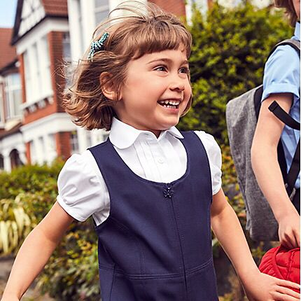 Girl wearing M&S school uniform
