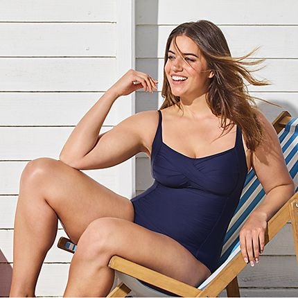 Woman in navy swimsuit