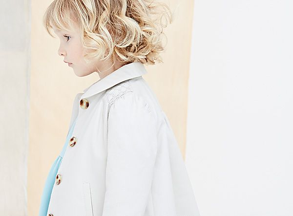 Girl wearing cream coat and pale blue dress from Marie Chantal's new summer collection