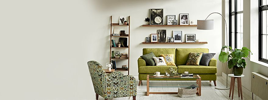 A sofa, armchair, shelving and coffee table