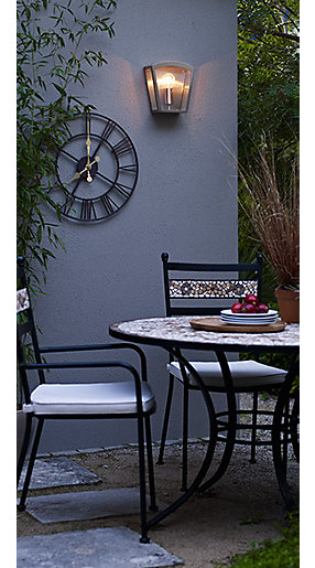 Outdoor lighting with a garden table and chairs