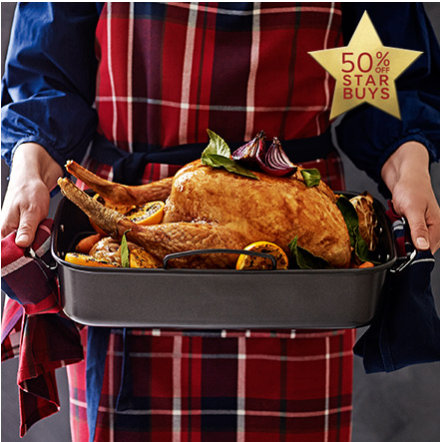 Woman holding roasting tin with cooked turkey