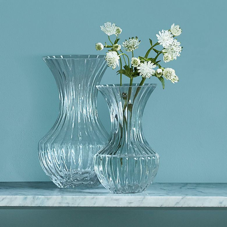 Clear glass vases with white flowers