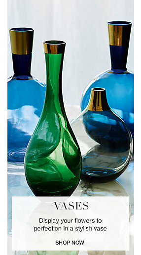 Green glass vases and blue glass vases