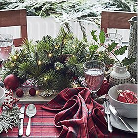 Crockery, cutlery and serveware on a Christmas table