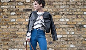 Woman in black jacket and stripe top