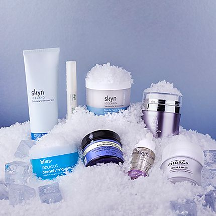 Skin care products embedded in snow