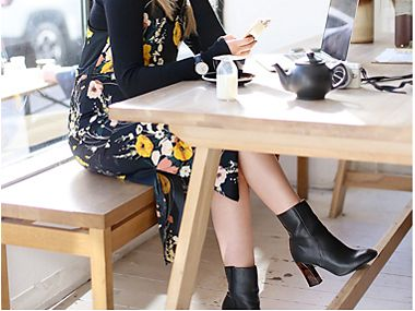 Woman in a cafe wearing ankle boots