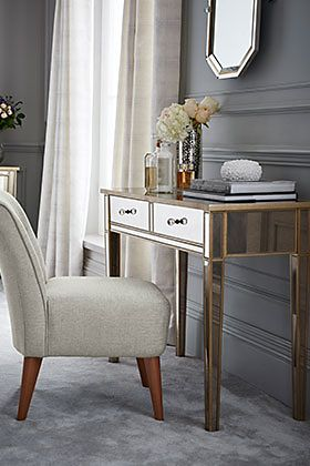 A dressing table and chair
