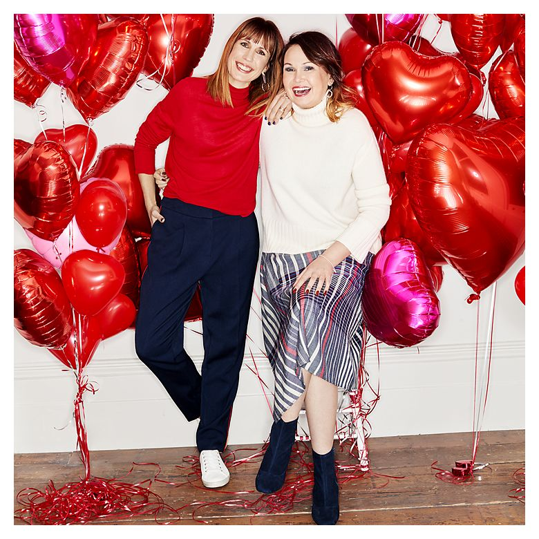 Nathalie Bailey-Flitter and sister Tanya Walker smiling in front of red love heart balloons