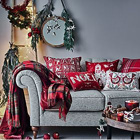 Sofa with Christmas cushions and throws