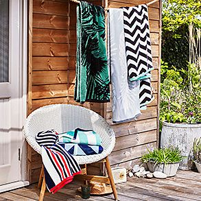 Beach towels on a garden chair