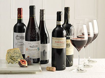 Selection of wine bottles and wine glass