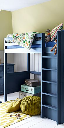 A bunk bed with childrens bedroom furniture and childrens bedding