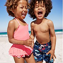 Boy and girl wearing swimwear on a beach