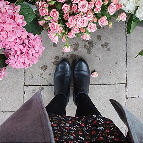Pair of chelsea boots surrounded by flowers