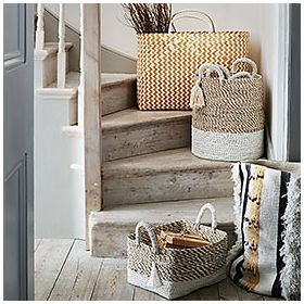 Storage baskets on stairs