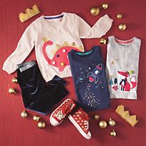Baby boy outfit on red Christmas background