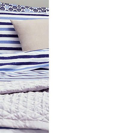 Striped bedding on a divan bed
