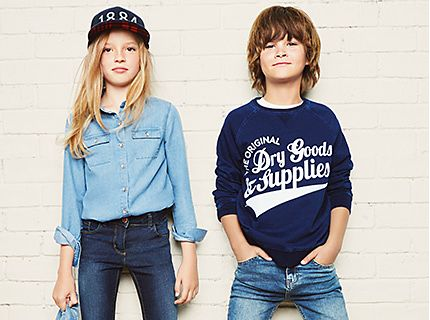 Girl in denim shirt and jeans, boy in blue T-shirt and jeans